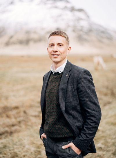 Destination Iceland wedding. Close-up man portrait. A...