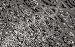 Roof metal structure in the main hall at the Louvre Abu...
