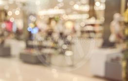Blurred shopping mall or department store interior...