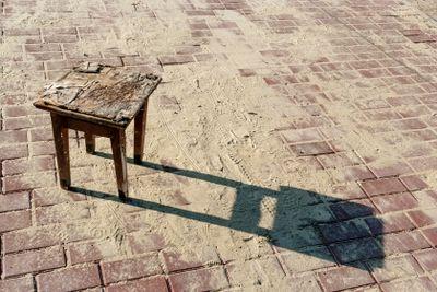 Old stool on brick road - 2.