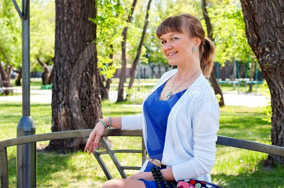 portrait of a beautiful woman in summer park