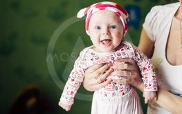 Little baby girl and her mother. Funny baby hat with...