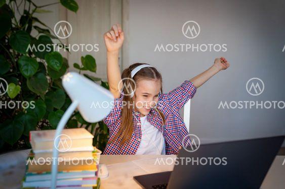 happy schoolgirl in headphones listen music