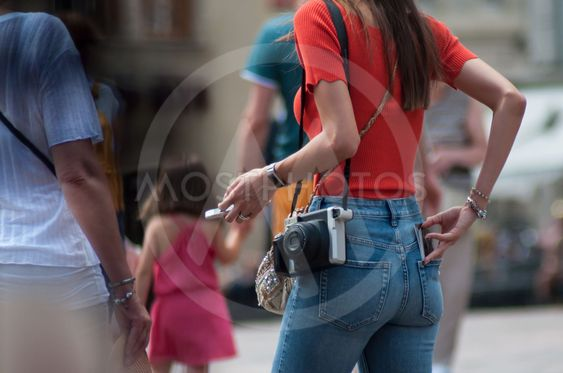 girl with snapshot camera in the street