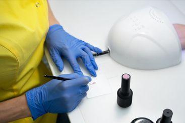 Nail care. Manicure in a manicure. the salon. The master...