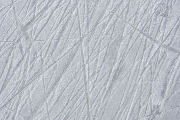 traces on the ice from skates on the rink