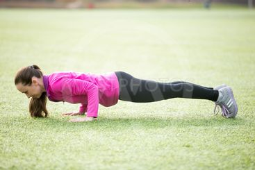 Yoga outdoors: chaturanga dandasana pose
