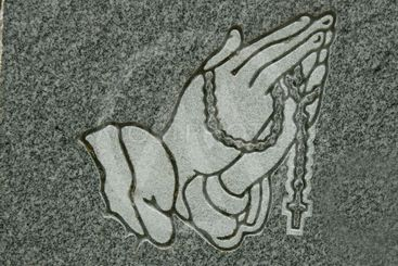 praying hands and rosary