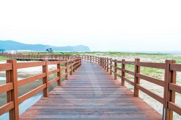 wood walkway at Dadaepo Beach in Busan