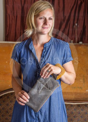 Blonde Woman With Gray Leather Clutch