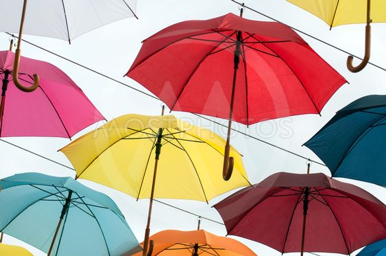 colorful umbrella suspended in the street