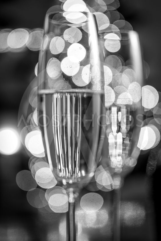 two champagne glasses on background of Christmas lights