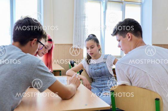 School, education, adolescence. Group of teenage...