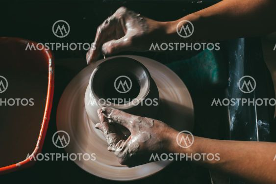 Creating a jar or vase of white clay close-up. Master...