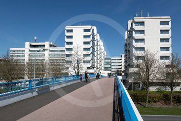 Footbridge to big white office buildings in the Netherlands