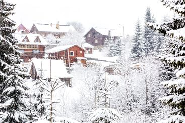 Snow-capped houses in the mountains