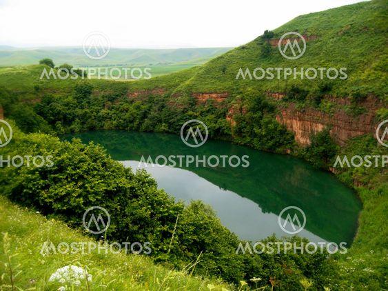 Sarmakovo lake between a caucasus mountains summertime