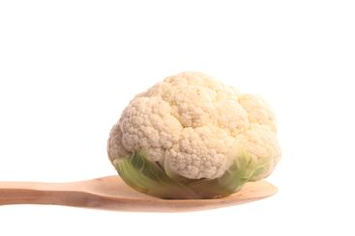 Mini cauliflower on a wooden spoon