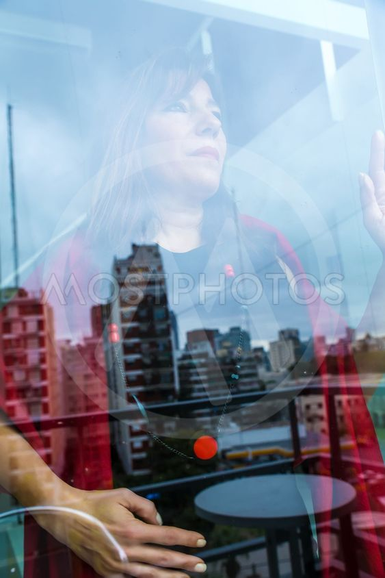 Mature woman looking out the window