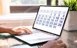 Businesswoman Looking At Calendar On Laptop