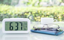 Digital clock and eyeglass with coffee cup