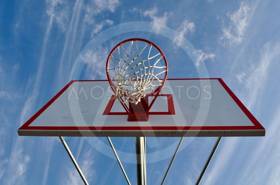 Basketball Hoop with Clouds and Blue Sky