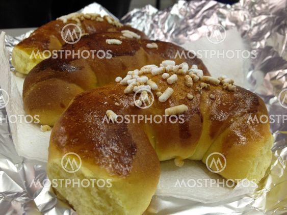 Croissants on sunlit breakfast table