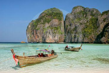 Longtail boat anchored at Maya Bay on Phi Phi Leh Island,...