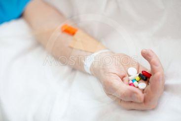 Senior man with pills