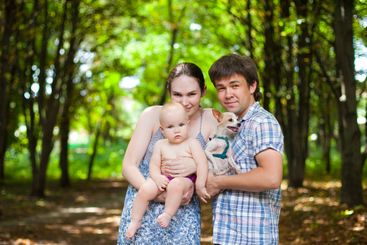 family in checkered shirts with baby daughter and small...