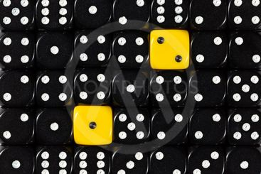 Background of random ordered black dices with two yellow...