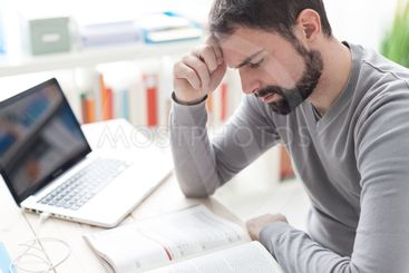 Exhausted man with headache