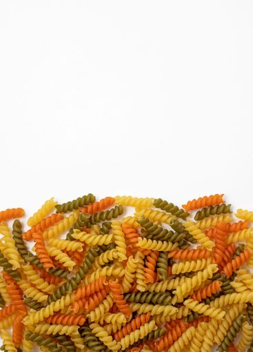 Tricolor, dry and raw pasta