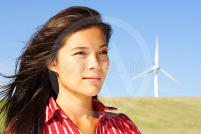 Woman by wind turbine