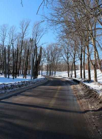 earth wall,roads, winter, trees, sunny day, blue sky, city,