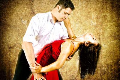 Cute young couple dancing latino