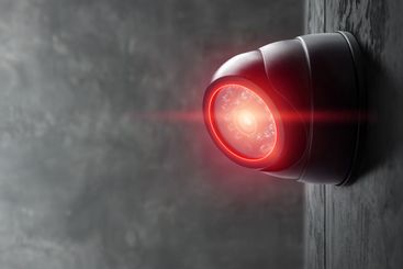Smart CCTV camera on the wall with red lights. Cameras...