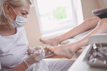 Professional medical pedicure procedure close up using...