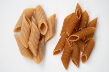 Raw and cooked dark whole grain pasta