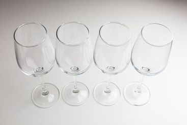 four glasses for wine on a light background