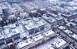 Aerial view of snowed in traditional housing suburbs