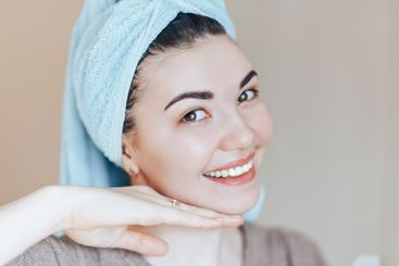 Spa skin care beauty woman wearing hair towel after...