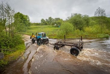 tractor crosses the river
