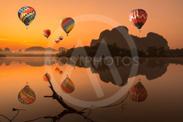 Watch the balloon with beautiful landscape of sunrise on...