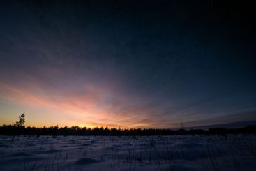 Epic sunset in winter with stars on the sky