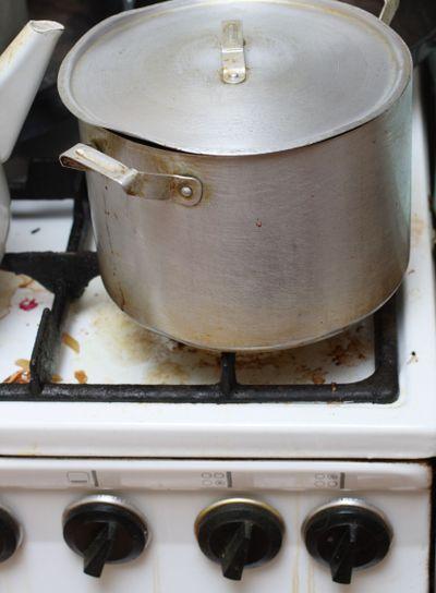 pan on old dirty gas stove