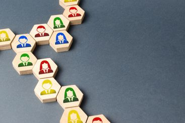 Symbols of employees on the chains of hexagons. business...
