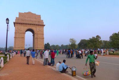 People walking around India Gate in New Delhi
