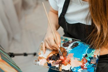 Art, the work of the artist. Young beautiful girl artist...