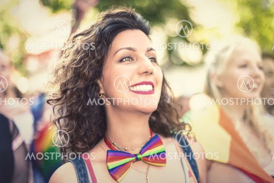 Happy brownhaired woman during the pride parade in...